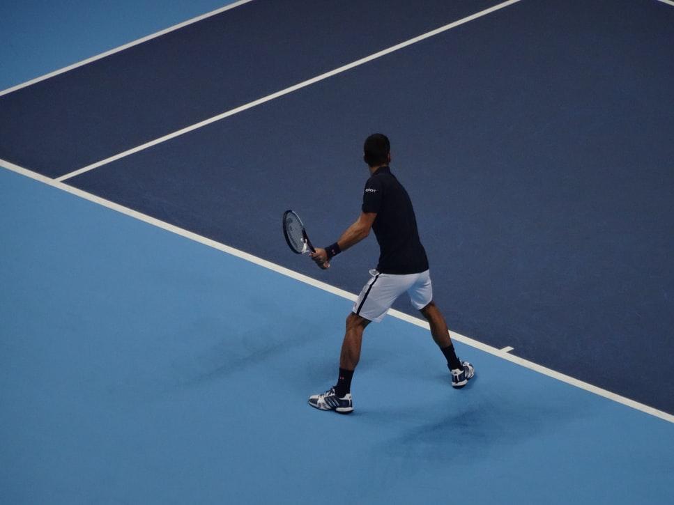 Novak playing on hard court